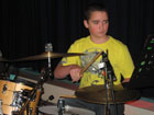 boy playing the drums reading music